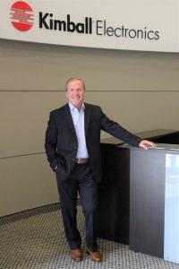 Don Charron in Lobby of Kimball Electronics World Headquarters